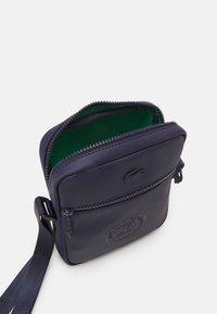 Lacoste Sport - VERTICAL CAMERA BAG - Across body bag - marine - 2