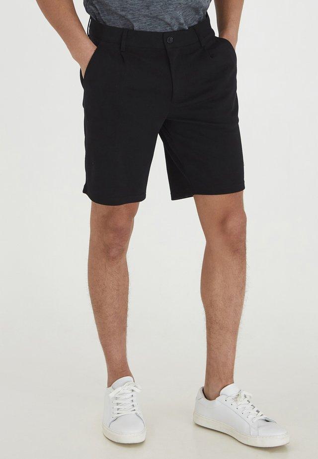 JANIS - Shorts - black