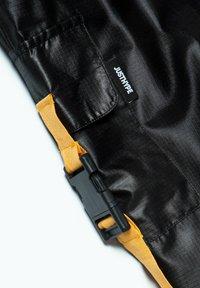 Hype - Tracksuit bottoms - orange/black - 4