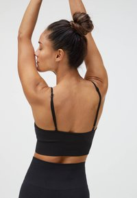 OYSHO - Light support sports bra - black - 4