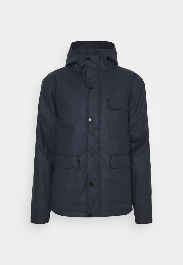 AKPER RAIN - Waterproof jacket - sky captain