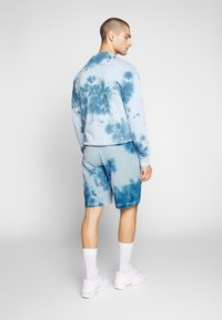 Russell Athletic Eagle R - ADAM - Tracksuit bottoms - copen blue - 2