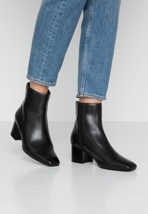 LEATHER BOOTIES - Classic ankle boots - black