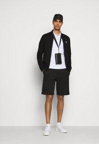EA7 Emporio Armani - Zip-up hoodie - black - 1