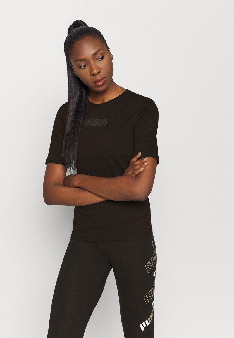 Puma - MODERN BASICS TEE - Camiseta estampada - black
