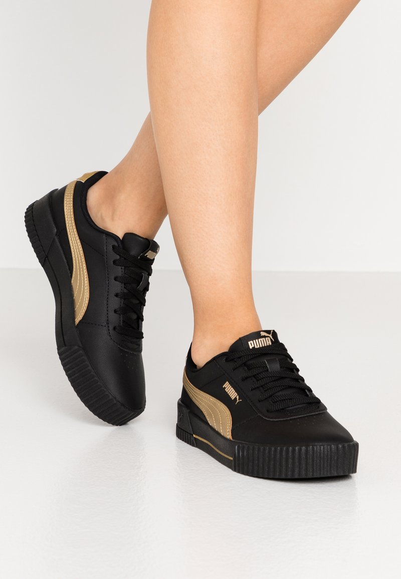 Puma - CARINA META20 - Sneaker low - black/team gold