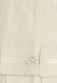Pegador - AYVO PANTS UNISEX - Cargo trousers - coconut milk - 5