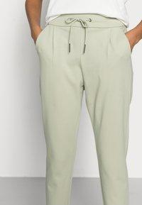 Vero Moda Petite - VMEVA LOOSE STRING PANTS - Trousers - desert sage - 3