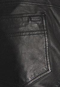 Tigha - TANO - Leather trousers - black - 6