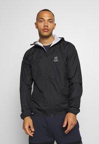 Haglöfs - PROOF MULTI JACKET MEN - Hardshell jacket - true black - 0