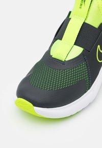 Nike Performance - FLEX PLUS UNISEX - Neutral running shoes - dark smoke grey/volt/white - 5