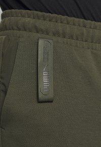 Puma - NU TILITY PANTS - Pantalon de survêtement - forest night - 4