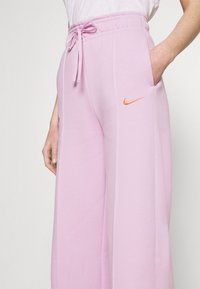 Nike Sportswear - PANT - Tracksuit bottoms - light arctic pink - 4