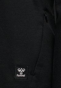 Hummel - HMLESSI  - Training jacket - black - 4