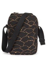 Eastpak - Across body bag - gold - 1