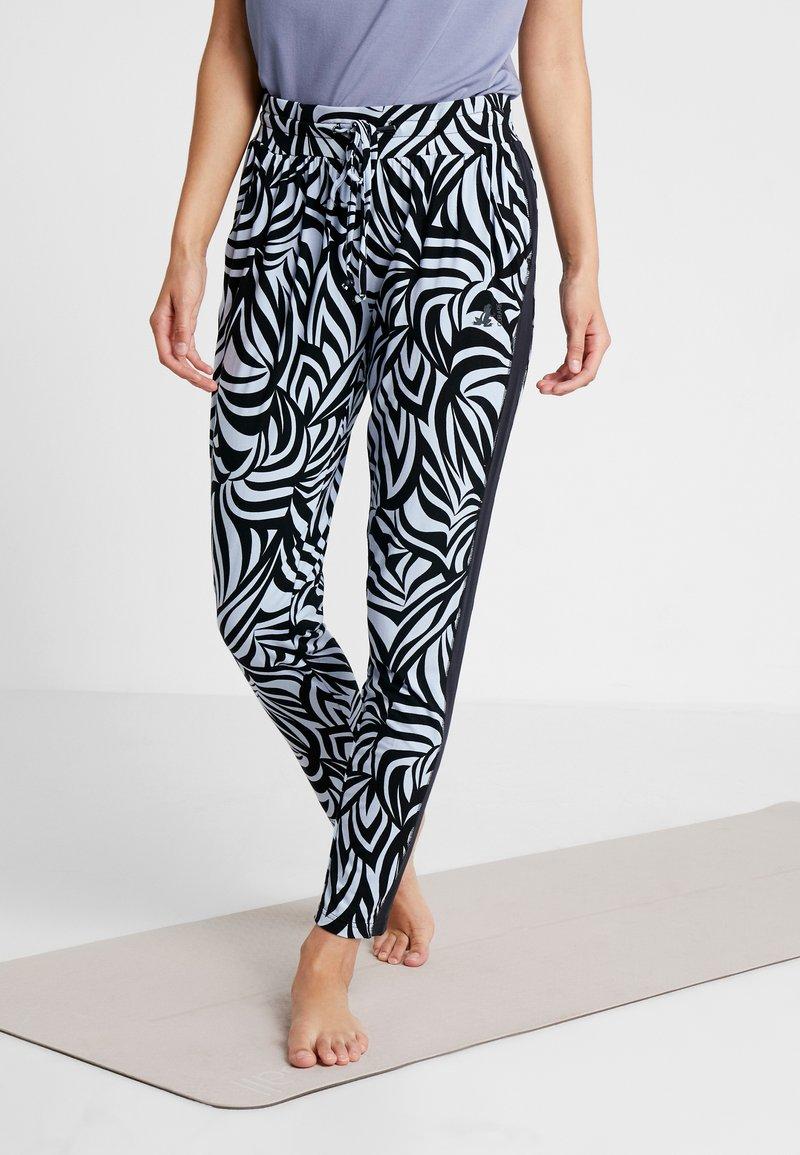 Curare Yogawear - PANTS GALON STRIPE - Tracksuit bottoms - grafik blue/midnight blue