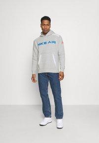 Nike Sportswear - AIR HOODIE - Hoodie - grey heather/summit white/infrared 23 - 1