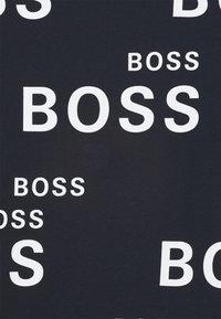 BOSS Kidswear - SHORT SLEEVES TEE - Print T-shirt - navy - 2