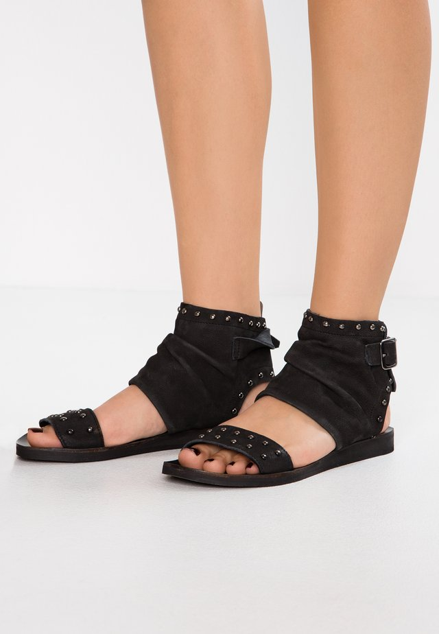 CAROLINA  - Ankle cuff sandals - pacific black
