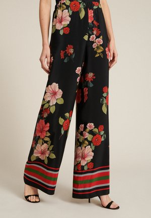AMICOS - Trousers - var nero/corallo