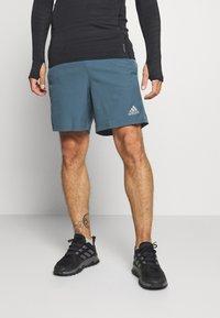adidas Performance - OWN THE RUN - Pantalón corto de deporte - blue - 0