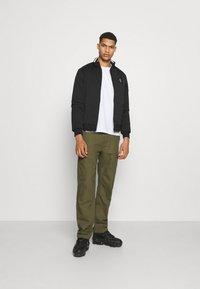 Calvin Klein Jeans - HARRINGTON PADDED JACKET - Light jacket - black - 1
