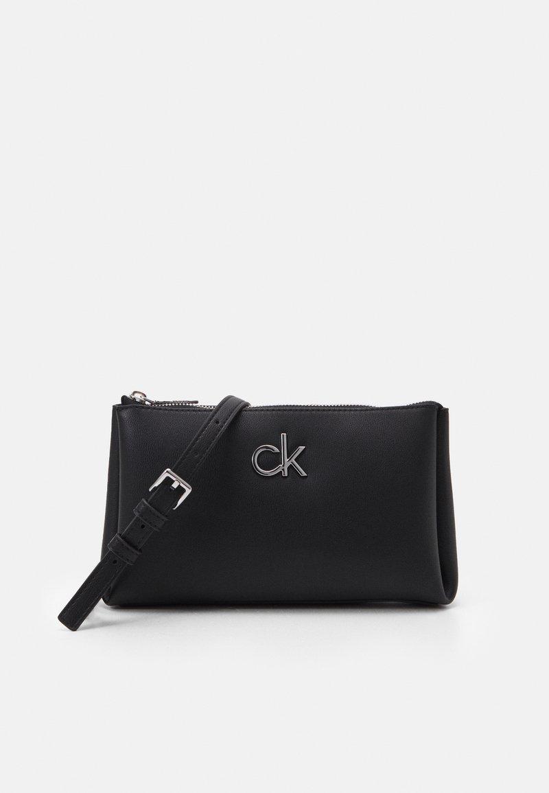 Calvin Klein - XBODY ZIP - Taška spříčným popruhem - black