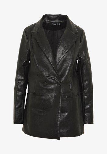 Halflange jas