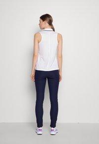 Kjus - IKALA TREGGINS WARM - Outdoor trousers - atlanta blue - 2