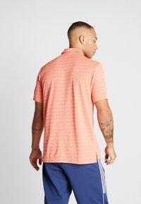 adidas Golf - STRIPE COLLECTION - Poloshirts - amber tint/signal coral - 2