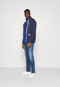 Tommy Jeans - SCANTON SLIM - Džíny Slim Fit - dynamic jacob mid blue stretch - 1