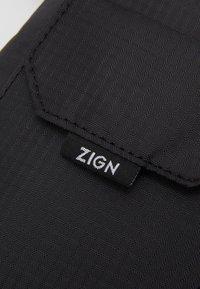 Zign - Taška spříčným popruhem - black - 2