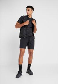 Nike Performance - SHORT YOGA - Sports shorts - black/iron grey - 1