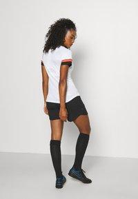 Nike Performance - W NK DF ACADEMY21  - T-shirt sportiva - white/black/bright crimson - 3