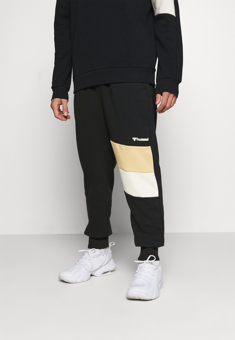Hummel - HMLAIDAN REGULAR PANTS - Tracksuit bottoms - black