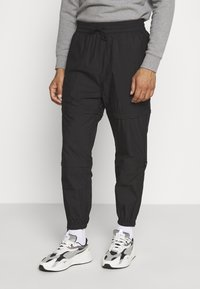 Weekday - ASTON ZIPPED TROUSERS - Trousers - black - 0