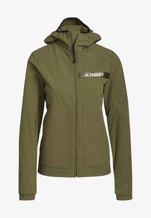 W MT SOFTSH - Soft shell jacket - green