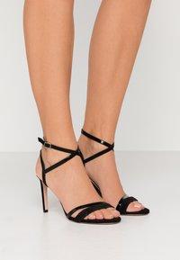 HUGO - High heeled sandals - black - 0