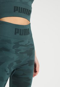 Puma - EVOKNIT SEAMLESS LEGGINGS - Tights - ponderosa pine - 4