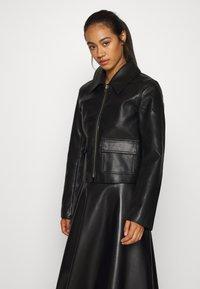 Weekday - TAXI JACKET - Faux leather jacket - black - 0