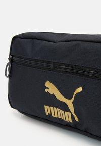 Puma - ORIGINALS WAIST BAG - Bum bag - black/gold - 3