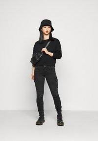 ONLY Petite - ONLCHRISSY LIFE BOXY - Sweatshirt - black - 1