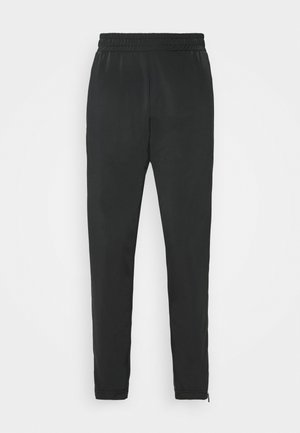 LACI PANTS - Tracksuit bottoms - black