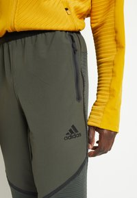 adidas Performance - Tracksuit bottoms - legear - 6