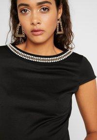 Vila - VISABINE CAPSLEEVE PEARL DRESS - Korte jurk - black - 3