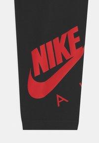 Nike Sportswear - FAVORITES - Leggings - Trousers - black/university red - 2