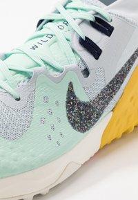 Nike Performance - WILDHORSE 6 - Trail running shoes - aura/blackened blue/mint/speed yellow/laser crimson/sail - 5