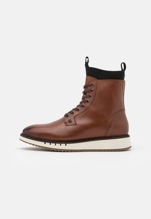 SPORT BOOT  - Lace-up ankle boots - winter cognac