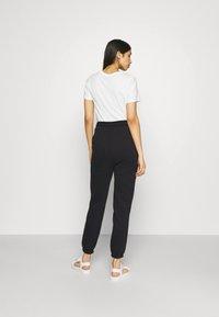 Even&Odd - HIGH WAIST LOOSE FIT SWEAT PANTS - Tracksuit bottoms - black - 2