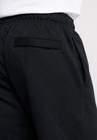 Nike Sportswear - CLUB - Tracksuit bottoms - black